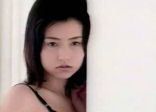 Azumi Kawashima with a longing look on her face