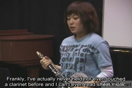Miki Hayakawa admits she has no musical experience while holding a clarinet