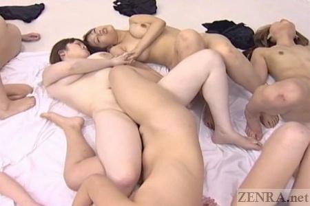 Voluptuous Japanese lesbians embrace