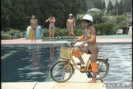 Nudist Japanese bicycle above pool obstacle course