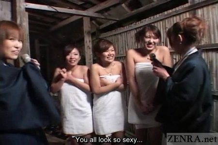 Shy Japanese women in towels at bathhouse