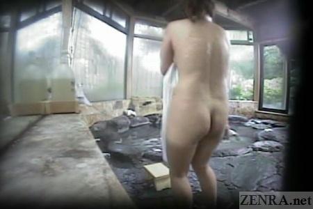 Shy Japanese woman in male bathhouse
