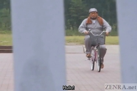 Heavyset Japanese man on pink bicycle