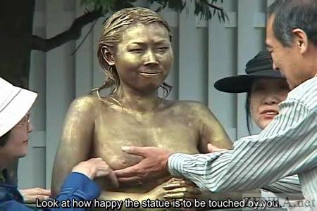 Realistic breasts felt by older Japanese man in park