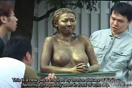 Japanese students look at naked statue