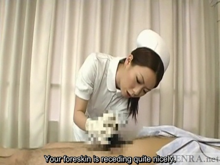 Japanese nurse closely inspects penis