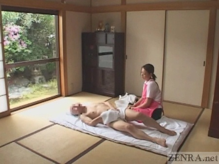 Old Japanese man cleans himself