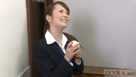 Japanese sex toy saleswoman showcases kinky masturbation apparatus