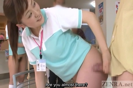 Smiling Japanese caretaker gives handjob via butt