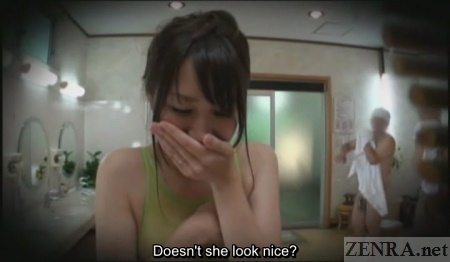 Embarrassed Japanese woman in coed changing room