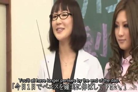 Optimistic Japanese teacher in class