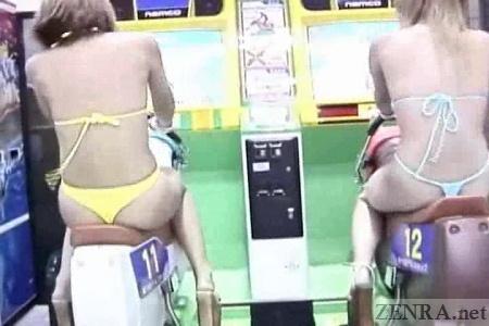 String bikini clad gyaru in a Japanese arcade