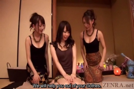 Demure Japanese woman with two masseuses