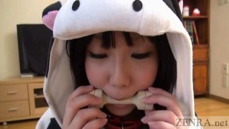 Cosplay pajama clad Japanese woman bites on toy bone