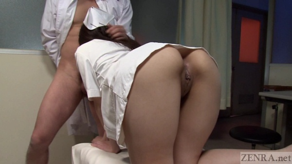 Bent over nusre gives blowjob to doctor
