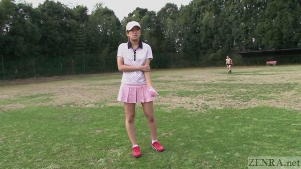 Japanese female golfer in pink uniform