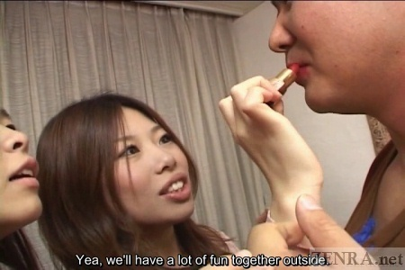 Japanese woman apply lipstick to man