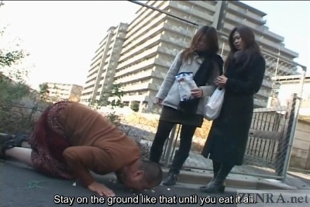 Japanese man instructed to eat off ground