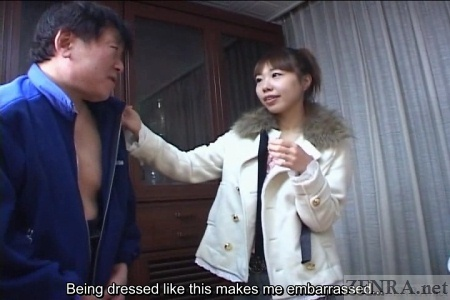 Extremely embarrassed Japanese man in drag