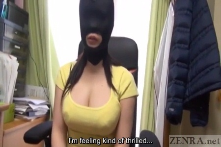 Busty Japanese woman in bondage mask