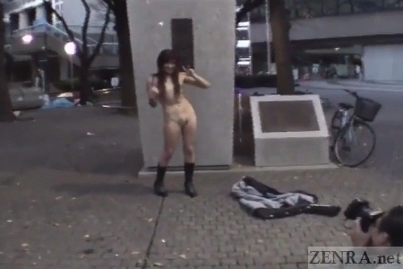 Japanese naked woman near statue