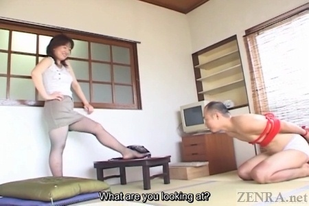 Bound Japanese man on tatami floor