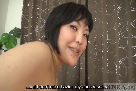 Embarrassed naked short hair Japanese woman
