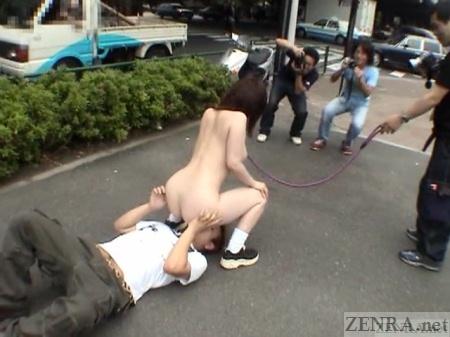 Japanese CMNF public nudist facesitting