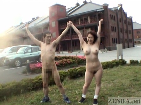 Nudist Japanese couple arms up and out