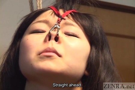 Japanese nose hook on schoolgirl close up
