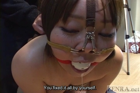 Ball gag with drooling zoomed in