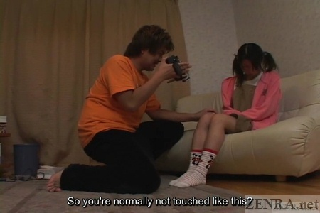 Otaku films legs of Japanese schoolgirl