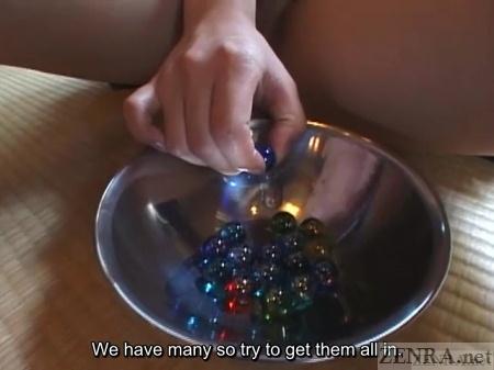 Japanese schoolgirl no panties handles marbles