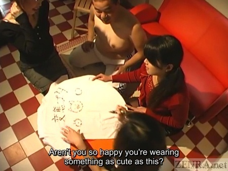 Japanese woman write dirty words on shirt