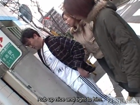Japanese man rubs against phone poll in public