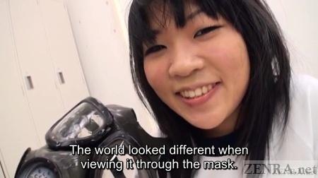Saya Takazawa holds up semen covered gas mask
