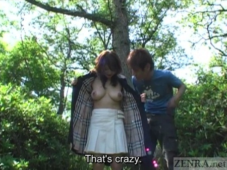 Busty Japanese woman flashes chest