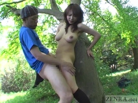 Japanese couple sex against tree