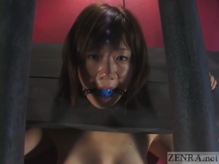 Nana Miyachi with ball gag in stocks