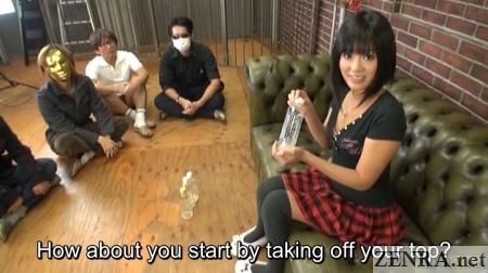 Uta Kohaku holds bottle of jizz