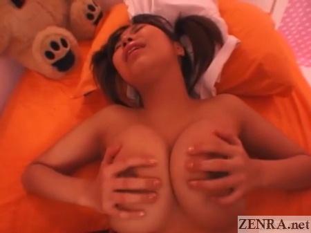Schoolgirl plays with huge breasts during sex