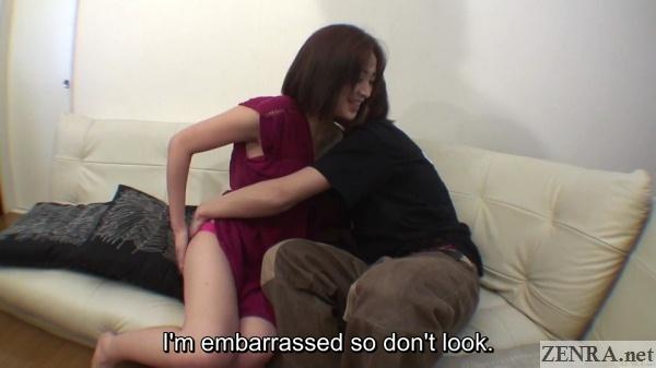 Embarrassed wife tries to hide panties