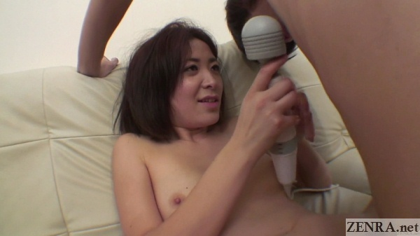 Aroused Japanese wife holds massager