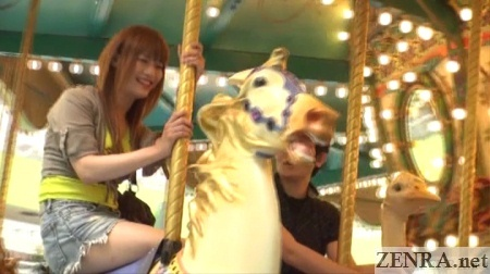 Kaoru Oshima rides carousel