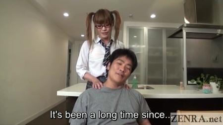 Schoolgirl cross-dresser gives shoulder massage