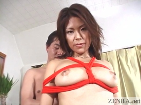 Naked Japanese woman bound in red rope