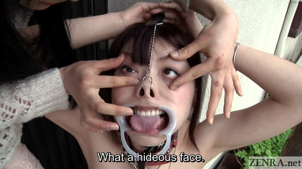 Tsubaki Katou weird face with cheek retractor