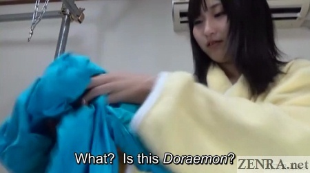Japanese woman tries on Zentai suit