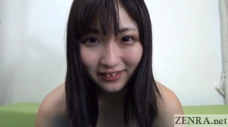 Smiling Japanese woman with black hair topless