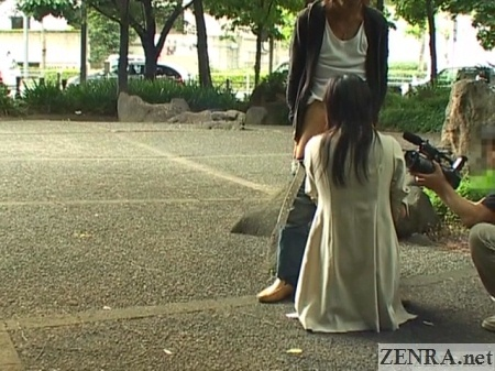 Japanese woman in trenchcoat public blowjob in park